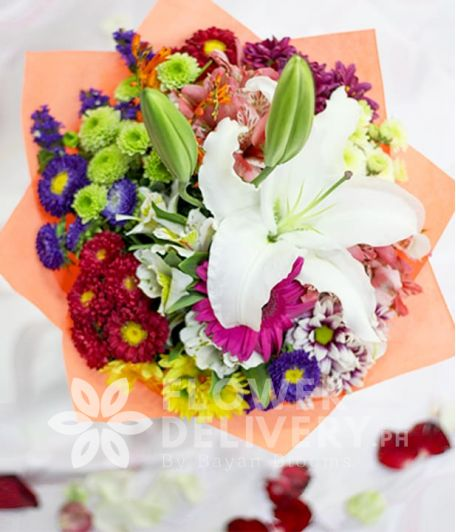 Casa Blanca with Mixed Colorful Flowers