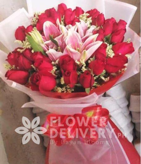3 Dozen Imported Red Roses with Stargazers