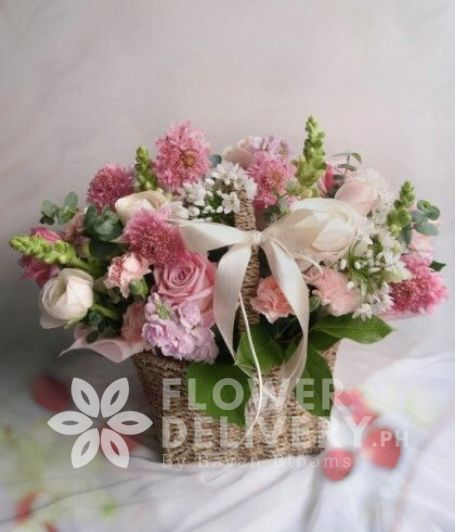 A Basket of Mixed Pink Flowers