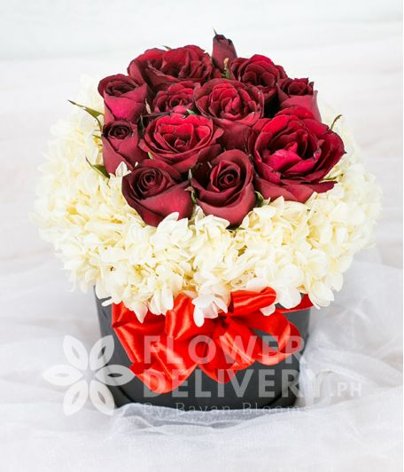 A Round Box of Dozen Red Roses with Hydrangea