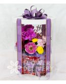 Elegant Flowers with Kitkat in a Round Box